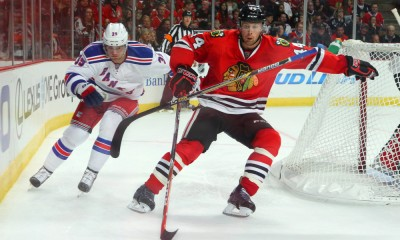 26 September 2014:  Chicago Blackhawks defenseman Klas Dahlbeck (44) battles with New York Rangers right wing Ryan Haggerty (39) in action during a preseason game between the New York Rangers and the Chicago Blackhawks at the United Center, in Chicago, IL.