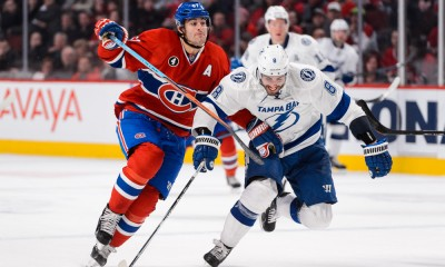 30 March 2015:  Max Pacioretty #67 of the Montreal Canadiens tries to skate past Mark Barberio #8 of the Tampa Bay Lightning during the NHL match at the Bell Centre in Montreal Quebec, Canada.  The Tampa Bay Lightning defeated the Montreal Canadiens 5-3.