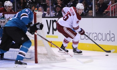 26 September 2014:  Arizona Coyotes center Henrik Samuelsson skates with the puck behind the San Jose Sharks net during a pre-season NHL hockey game between the Arizona Coyotes and the San Jose Sharks at the SAP Center in San Jose, CA.