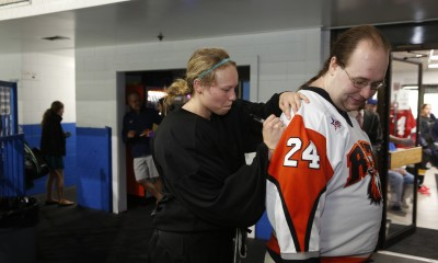 Celeste Brown signs fan's jersey after camp. Mandatory photo credit: Right Angle Studios and the NWHL