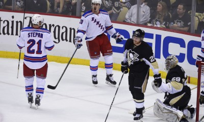 20 April 2015: New York Rangers left wing Chris Kreider (20) celebrates his goal on Pittsburgh Penguins goalie Marc-Andre Fleury (29) during the second period of Game Three of the First Round in the 2015 NHL Stanley Cup Playoffs between the New York Rangers and the Pittsburgh Penguins, held at the Consol Energy Center in Pittsburgh, Pennsylvania.