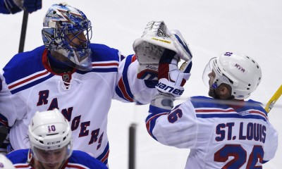 22 April 2015: New York Rangers goalie Henrik Lundqvist (30) and right wing Martin St. Louis (26) celebrate after a 2-1 win during the overtime period. The New York Rangers take a 3-1 series lead with the win against the Pittsburgh Penguins in Game Four of the 2015 NHL Stanley Cup Playoffs - First Round at the Consol Energy Center in Pittsburgh, Pennsylvania.