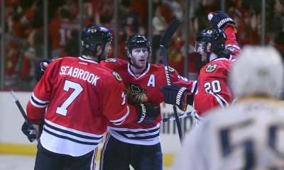 25 April 2015:  Chicago Blackhawks defenseman Duncan Keith (2) celebrates with teammates after scoring the winning goal in the third period in action during game 6 of Round One between the Nashville Predators and the Chicago Blackhawks at the United Center, in Chicago, IL.