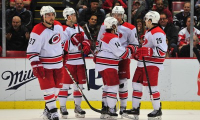 April 7, 2015:Carolina Hurricanes left wing Nathan Gerbe (14) is congratulated by his line mates after scoring during the game on Tuesday evening, Joe Louis Arena, Detroit, Michigan.