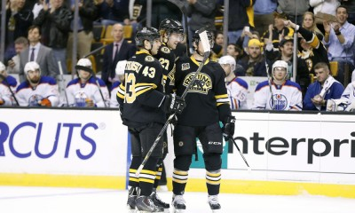 February 1, 2014: Teammates congratulate Boston Bruins' Dougie Hamilton (27) on his goal. The Boston Bruins defeated the Edmonton Oilers 4-0 in a regular season NHL game at TD Garden in Boston, Massachusetts.