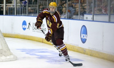 March 27, 2015: University of Minnesota Defenseman Mike Reilly (5) looks to pass out from behind the goal. The University of Minnesota-Duluth Bulldogs defeated the University of Minnesota Golden Gophers 4-1 in the semi-final of the NCAA Division 1 Men's Northeast Regional at Verizon Wireless Arena in Manchester, NH.