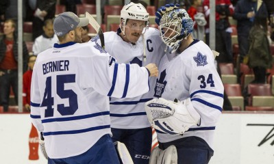 December 10, 2014:  Toronto Maple Leafs defenseman Dion Phaneuf (3), center, and backup goalie Jonathan Bernier (45) congratulate goalie James Reimer (34) at the conclusion of a regular season NHL hockey game between the Toronto Maple Leafs and the Detroit Red Wings played at Joe Louis Arena in Detroit, Michigan.  The Toronto Maple Leafs defeated the Detroit Red Wings 2-1 in a shootout.