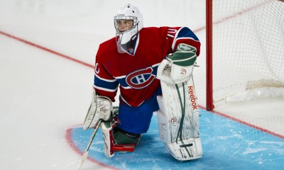 15 September 2013:  Goaltender Zachary Fucale #70 of the Montreal Canadiens is on one knee during the NHL preseason game against the Buffalo Sabres at the Bell Centre in Montreal Quebec, Canada.  The Sabres defeat the Canadiens 5-4 in a shootout.