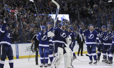 29 April 2015: Tampa Bay Lightning goalie Ben Bishop (30) and the Tampa Bay Lightning raise their sticks after their 2-0 victory of Game 7 of the First Round of the Stanley Cup Playoffs between the Detroit Red Wings and Tampa Bay Lightning at Amalie Arena in Tampa, FL