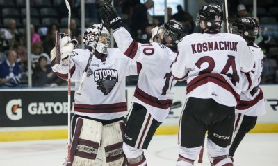 May 19, 2014:   Guelph Storm goalie Justin Nichols and other players from the Storm celebrate at the end of their game against the Val-d'Or Foreurs at the 2014 Memorial Cup in London Ontario, Canada. Guelph went on to beat Val d'Or by a score of 6-3 to be the only undeated team in the tournament.
