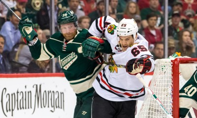 MAY 04, 2015: Minnesota Wild defenseman Jordan Leopold (33) and Chicago Blackhawks forward Andrew Shaw (65) skates after the puck in the third period at Xcel Energy Center, St. Paul, MN. The Chicago Blackhawks beat Minnesota Wild 1-0.