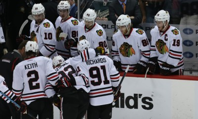 May 7, 2015 Blackhawks defensemen Michal Rozsival (32) is helped off the ice by teammates defensemen Duncan Keith (2) and forward Brad Richards (91) during the first period at the Minnesota Wild vs Chicago Blackhawks at Excel Energy Center.
