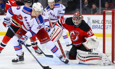 07 APR 2015:  New York Rangers left wing Chris Kreider (20) in front of New Jersey Devils goalie Cory Schneider (35) during the third period of the game between the New Jersey Devils and the New York Rangers played at the Prudential Center in Newark,NJ. The New York Rangers defeat the New Jersey Devils 4-2 and win the Presidents Trophy.