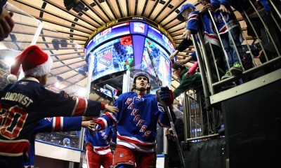 December 21, 2014: New York Rangers Left Wing Rick Nash (61) [2288] high fives fans as he leaves the ice after player warm-ups prior to a Metropolitan Divisional match-up between the Carolina Hurricanes and the New York Rangers at Madison Square Garden in New York, NY.
