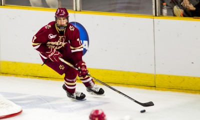 March 28, 2015: Boston College Defense Noah Hanifin #7 brings the puck from behind the net during the first round of the 2015 NCAA East Regional game between the University of Denver Pioneers and the Boston College Eagles at the Dunkin Donuts Center in Providence, RI.
