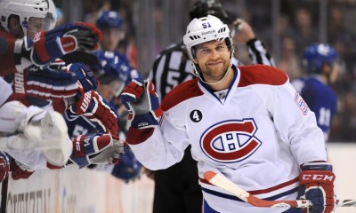 April 11, 2015:  Montreal Canadiens forward David Desharnais (51) smiles as he is greeted at the bench by team mates after scoring in the overtime shootout against Toronto Maple Leafs at the Air Canada Centre, Toronto, ON.The Canadiens beat the Leafs 4-3.