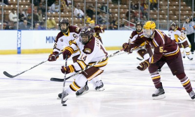 March 27, 2015: University of Minnesota-Duluth Forward Alex Iafallo (14) breaks past University of Minnesota Defenseman Mike Reilly (5). The University of Minnesota-Duluth Bulldogs defeated the University of Minnesota Golden Gophers 4-1 in the semi-final of the NCAA Division 1 Men's Northeast Regional at Verizon Wireless Arena in Manchester, NH.