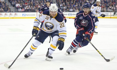 April 10, 2015; Buffalo Sabres left wing Johan Larsson (22) and Columbus Blue Jackets center Marko Dano (56) battle for the puck during the third period between the Columbus Blue Jackets and the Buffalo Sabres held at the Nationwide Arena in Columbus, Ohio. Columbus Blue Jackets won 3-2.
