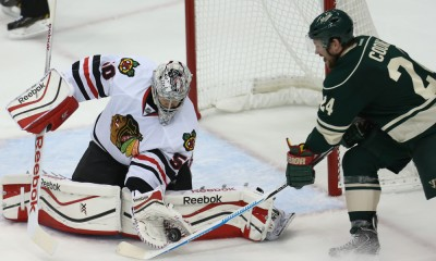 May 7, 2015 Wild forward Matt Cooke (24) tries to get the shot past Blackhawks goalie Corey Crawford (50) during the second period at the Minnesota Wild vs Chicago Blackhawks at Excel Energy Center.