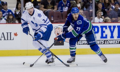 14 March 2015 : Vancouver Canucks Center Shawn Matthias (27) attempts to check Toronto Maple Leafs Defenceman Dion Phaneuf (3)   during a game at Rogers Arena in Vancouver, British Columbia, Canada.   ****For Editorial Use Only****