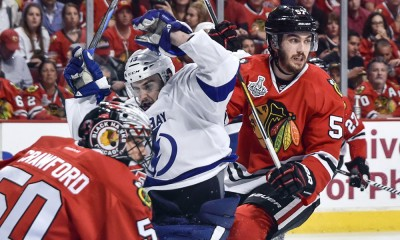 15 June 2015:  Tampa Bay Lightning Center Cedric Paquette (13) [9861] battles with Chicago Blackhawks Defenceman Trevor van Riemsdyk (57) [8749] and Chicago Blackhawks Goalie Corey Crawford (50) [3760] in action during game Six of the Stanley Cup Finals between the Tampa Bay Lightning and the Chicago Blackhawks at the United Center, in Chicago, IL.
