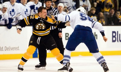 18 December 2008: Bruins forward Shawn Thornton #22 and the Maple Leafs' Andre Deveaux #56 trade punches during the Boston Bruins win 8-5 over the Toronto Maple Leafs at the TD Banknorth Garden in Boston, MA.*****Editorial Usage Only*****