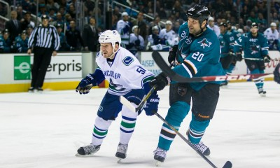 March 07, 2015: San Jose Sharks left wing John Scott (20) takes a shot on goal as Vancouver Canucks right wing Derek Dorsett (51) watches, during an NHL hockey game between the San Jose Sharks and the Vancouver Canucks at SAP Center in San Jose, California, USA. The Vancouver Canucks defeated the San Jose Sharks 3-2 in regulation time.
