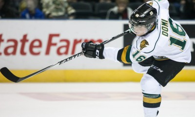 December 5, 2014. Max Domi (16) of the London Knights takes a shot during a game between the London Knights and the Sault Ste. Marie Greyhounds. The Greyhounds defeated the Knights 4-0 at Budweiser Gardens in London Ontario, Canada.
