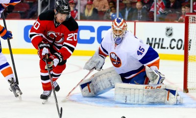 11 APR 2014: New Jersey Devils center Ryan Carter (20) goes for the puck in front of New York Islanders goalie Anders Nilsson (45) during the second period of the game between the New Jersey Devils and the New York Islanders played at the Prudential Center in Newark,NJ. The New York Islanders defeated the New Jersey Devils 3-2 in a shootout.