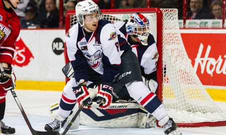 WINDSOR, ON - NOVEMBER 06: Trevor Murphy #8 of the Windsor Spitfires defends against the Owen Sound Attack on November 6, 2014 at the WFCU Centre in Windsor, Ontario, Canada.  (Photo by Dennis Pajot/Getty Images)