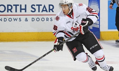 LONDON, ON - FEBRUARY 6:  Josh Ho-Sang #26 of the Niagara IceDogs skates with the puck against the London Knights during an OHL game at Budweiser Gardens on February 6, 2015 in London, Ontario, Canada. The IceDogs defeated the Knights 4-1. (Photo by Claus Andersen/Getty Images)