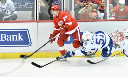 April 27, 2015:Tampa Bay Lightning center Valtteri Filppula (51) can't strip the puck from Detroit Red Wings defenseman Marek Zidlicky (28) during the Stanley Cup Playoffs Eastern Conference Round 1 Game 6 game on Monday evening, Joe Louis Arena, Detroit, Michigan.