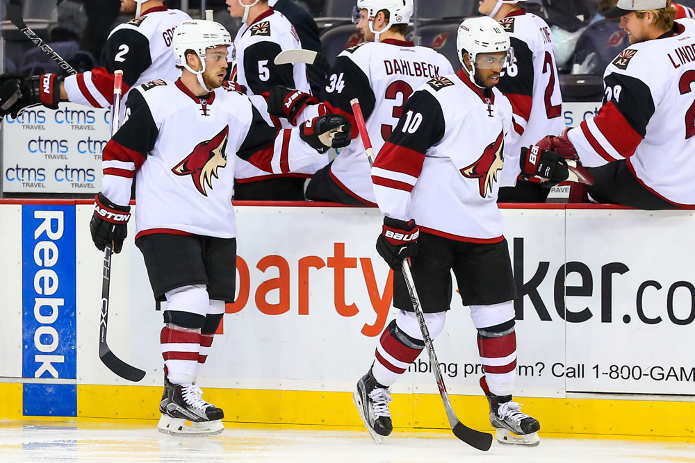 20 OCT 2015: Arizona Coyotes left wing Anthony Duclair (10) and teammate Arizona Coyotes center Max Domi (16) after scoring during the second period of the game between the New Jersey Devils and the Arizona Coyotes played at the Prudential Center in Newark,NJ. (Photo by Rich Graessle/Icon Sportswire)
