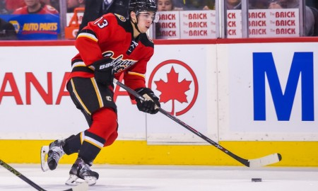 26 March 2016: Calgary Flames Left Wing Johnny Gaudreau (13) [9261] skates with the puck during an NHL Hockey game between the Calgary Flames and the Chicago Blackhawks at the Scotiabank Saddledome in Calgary, AB. (Photo by Jose Quiroz/Icon Sportswire)