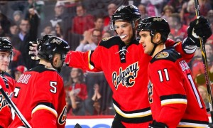 Calgary Flames Defenceman Mark Giordano (5) [2743], Calgary Flames Left Wing Micheal Ferland (79) [8525] and Calgary Flames Center Mikael Backlund (11) [6417] congratulate Calgary Flames Winger Joe Colborne (8) [6648] after scoring the second goal during an NHL Hockey game between the Calgary Flames and the Winnipeg Jets at the Scotiabank Saddledome in Calgary, AB. (Photo by Jose Quiroz/Icon Sportswire)