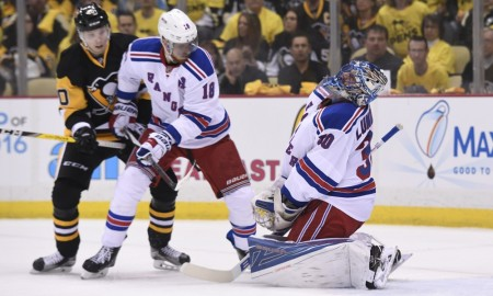 13 April 2016: New York Rangers goalie Henrik Lundqvist (30) reacts after getting hit by teammate defenseman Marc Staal (18) during the first period of Game One of the First Round in the 2016 NHL Stanley Cup Playoffs between the New York Rangers and the Pittsburgh Penguins, held at the Consol Energy Center in Pittsburgh, Pennsylvania.