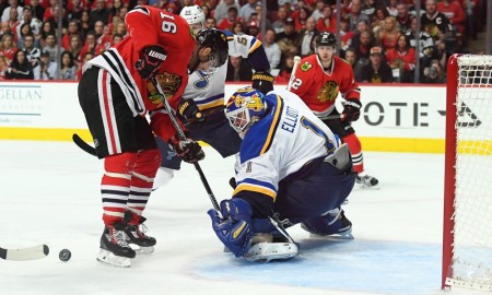 St. Louis Blues Goalie Brian Elliott (1) [3765] battles with Chicago Blackhawks Left Wing Andrew Ladd (16) [4409] to block a shot in the first period of action during the Game three of the first round of the NHL Playoffs between the Chicago Blackhawks and the St. Louis Blues at the United Center, in Chicago, IL. (Photo by Robin Alam/Icon Sportswire)