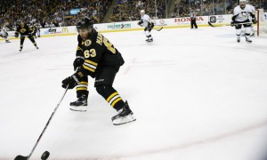 24 February 2016: Boston Bruins left wing Brad Marchand (63) [5756] tries to control the puck along the boards. The Boston Bruins defeated the Pittsburgh Penguins 5-1 in a regular season NHL game at TD Garden in Boston, Massachusetts. (Photograph by Fred Kfoury III/Icon Sportswire)