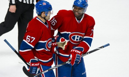 P.K. Subban #76 of the Montreal Canadiens celebrates with teammate Max Pacioretty #67 during the NHL game against the Carolina Hurricanes at the Bell Centre in Montreal Quebec, Canada. Photographer: Minas Panagiotakis/Icon Sportswire