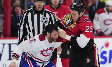 March 19, 2016: Ottawa Senators Right Wing Chris Neil (25) [1585] fights with Montreal Canadiens Right Wing Mike Brown (13) [4524] during the NHL game between the Ottawa Senators and the Montreal Canadians at Canadian Tires Centre in Ottawa, Ontario, Canada. (Photo by Steve Kingsman/Icon Sportswire)