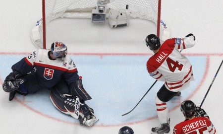 Canada's Taylor Hall, left, scores a goal to Slovakia's goalkeeper Julius Hudacek during the Hockey World Championships Group B match in St.Petersburg, Russia, Saturday, May 14, 2016. (AP Photo/Dmitri Lovetsky)