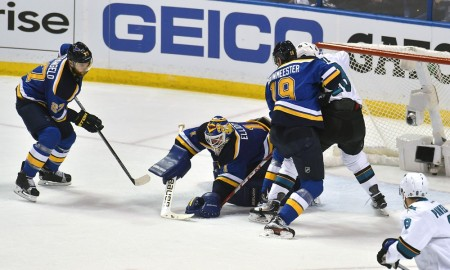 St. Louis Blues goalie Brian Eliott (1) covers the puck in the second period during a NHL Western Conference Final Game 1 of the Stanley Cup Playoffs between the San Jose Sharks and the St. Louis Blues at Scottrade Center in St. Louis, Mo. (Photo by Keith Gillett/Icon Sportswire)