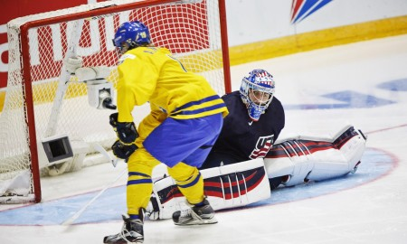 Alexander Nylander of Sweden scores behind the goalkeeper Alex Nedeljkovic of USA during the 2016 IIHF World Junior Ice Hockey Championship match between Sweden and USA in Helsinki, Finland, Monday, Dec. 28, 2015. (Roni Rekomaa/Lehtikuva via AP)