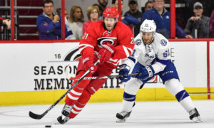 September 30, 2016 Tampa Bay Lightning forward Gabriel Dumont (61) steals the puck Carolina Hurricanes forward Lee Stempniak (21) in a preseason game between the Carolina Hurricanes and the Tampa Bay Lightning at PNC Arena in Raleigh, NC. (Photo by Greg Thompson/Icon Sportswire)