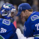 15 Oct 2016; Vancouver Canucks Goalie Ryan Miller (30) and Goalie Jacob Markstrom (25) celebrate the Canucks victory against the Calgary Flames during a game at Rogers Arena in Vancouver BC. (Photo by Bob Frid/Icon Sportswire)