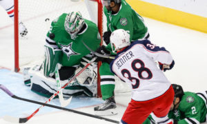 Dallas Stars Goalie Kari Lehtonen (32) blocks a shot by Columbus Blue Jackets Left Wing Boone Jenner (38) during the NHL game between the Columbus Blue Jackets and Dallas Stars at the American Airlines Center in Dallas, Texas. (Photo by Andrew Dieb/Icon Sportswire)